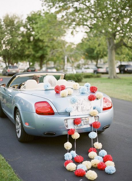 Cute Pom poms for the get away car #wedding #justmarried