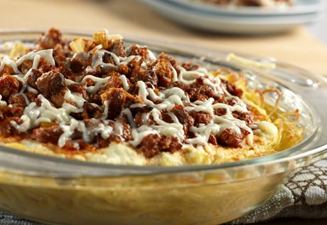 Tender spaghetti forms a crust that's filled with a kicked-up, beef-mushroom-tomato sauce and lots of cheese in this creative main-dish pie.