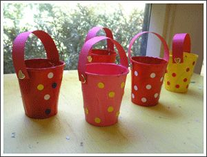 Paper cup buckets.  (Needed:  Paper Cups, hole punch, paint, construction paper, brads, stickers.)