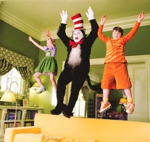 """The Cat, Sally and Conrad jumping on the couch in """"The Cat in the Hat"""""""