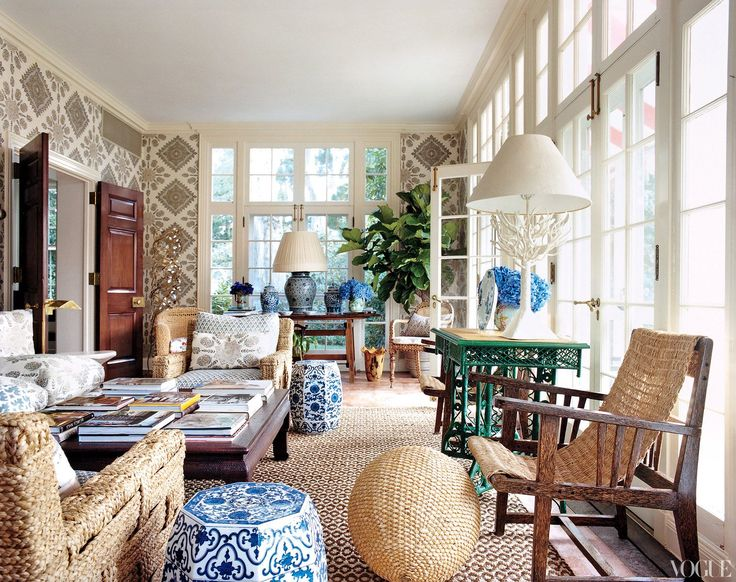 Earthly Delights - Quadrille linens, antique blue-and-white china, and woven chairs from John Himmel, found through antiques dealer John Rosselli, in the solarium.