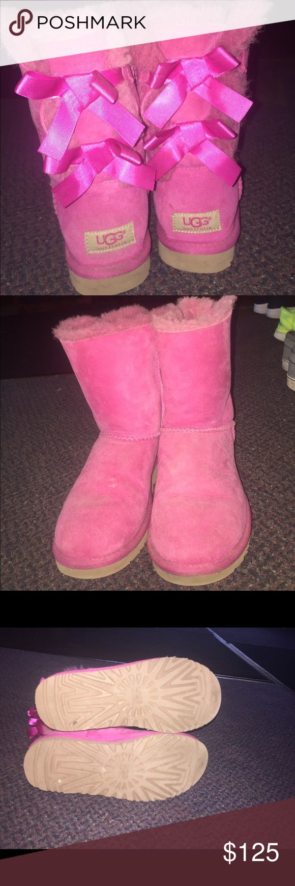 Excellent Condition Pink Bow Uggs Authentic and purchased from an ugg store. Only worn a handful of times. Selling because I want a more neutral color. Price is firm. No PayPal or other apps. No trades UGG Shoes Ankle Boots & Booties
