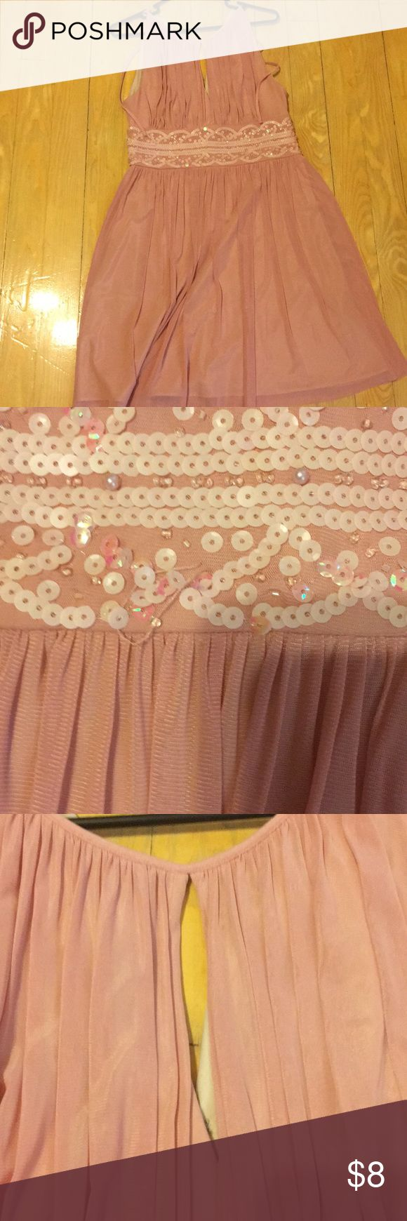 Pale rose color mid length dress Beautiful pale rose color, sheer outer layer with a solid 'slip' under. Sequence beneath breast are slightly flawed. Key hole at neck line. Sleeveless. Ties and zips in the back Dresses Midi