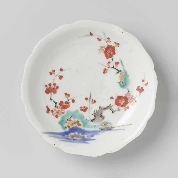 Scalloped saucer with rocks, prunus and bird, Anonymous, , c. 1670 - c. 1700, Rijksmuseum Amsterdam