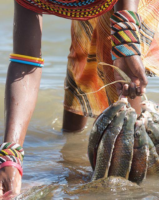 Washing Fish, Lake Turkana, Kenya - BelAfrique your personal travel planner - www.BelAfrique.com