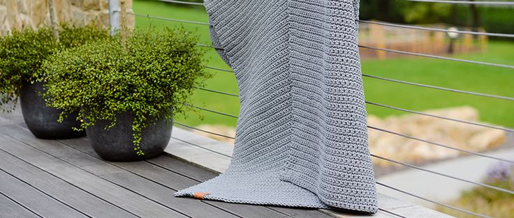 Knitted and Crocheted Home  Furnishings. Grey rug. Beautiful design.