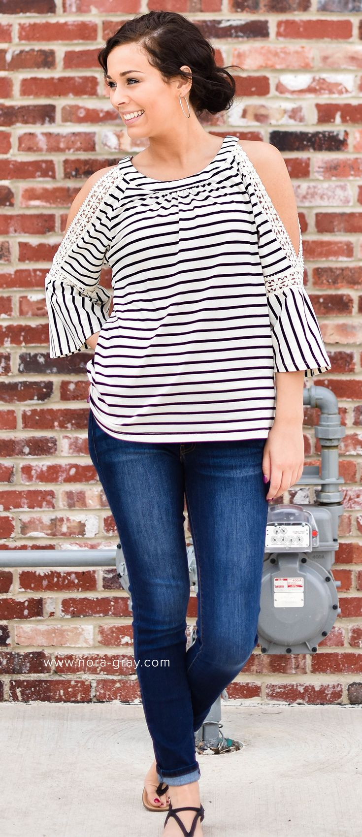 Get the Pearl Open Shoulder Top now at Nora Gray Boutique located in Berne, Indiana or online at www.nora-gray.com. All orders online receive FREE SHIPPING always! The Pearl is the perfect boutique top featuring fun stripes and lace shoulders. Download Nora Gray Boutique in your App Store to keep up with new arrivals, new deals and more!