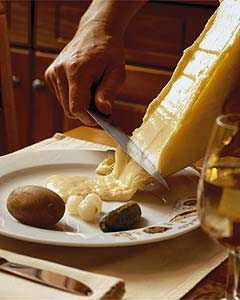 Raclette...this is an old Swiss treat...served from street vendors. A boiled potato, a little pickle and a layer of melted cheese from a wheel that is against a grill or flame. Sounds odd but a delightful snack.