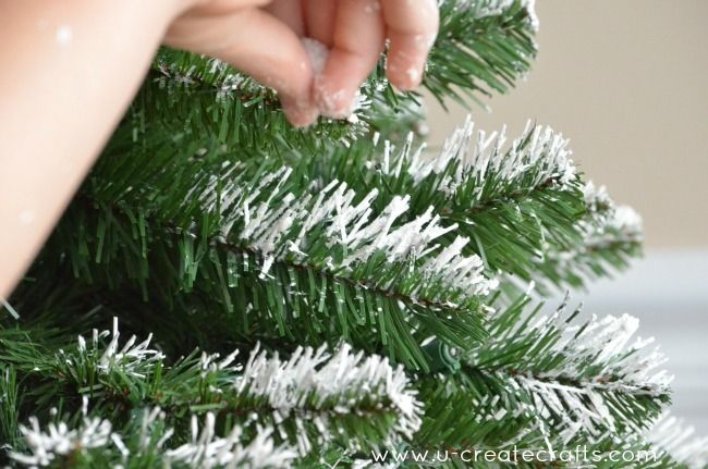 easy diy flocking: dab on white acrylic paint, and while it's still wet, sprinkle on a bit of glitter.  Try on a wreath?