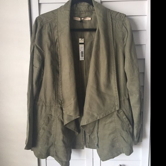 "Size L, Oct. 2016: Max Jeans Olive Green Khaki Vetiver Tencel Drape Long Jacket  Max Jeans Designer Brand Women's Military Style Drape Jacket Size Large Draped Front With Large Draped Collar Adjustable Drawstring Tie Waist Slit Hip Pockets Color: ""Soft Light Olive Green/Khaki -- 100% Tencel Retails for $110.00 Gorgeous Super Soft Jacket!Style #X116TH897J    ----Approximate Measurements (Taken While Lying Flat):Bust (Underarm to Underarm) 22"" Across Waist 21"" Across Length 26""Brand New With…"