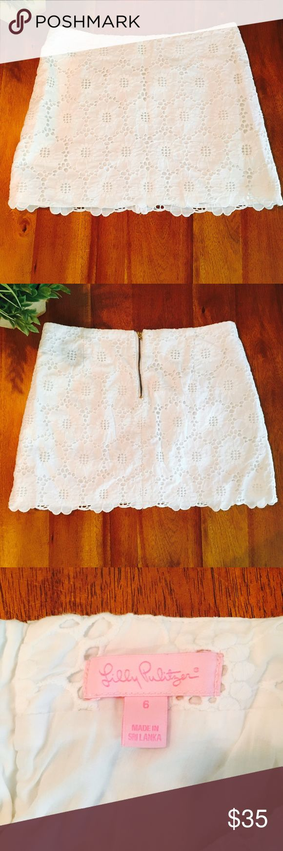 Lilly Pulitzer white floral embroidered mini skirt Lilly Pulitzer white mini skirt with white floral detail. Zipper works, but a piece is broken off (see last picture) reflected in price. Size 6. Lilly Pulitzer Skirts