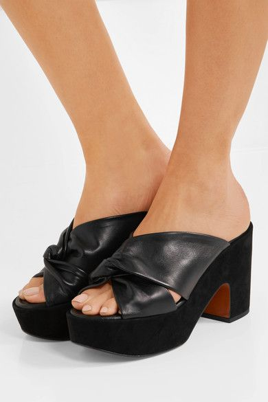 Suede heel measures approximately 105mm/ 4 inches with a 40mm/ 1.5 inches platform Black leather Slip on  Made in France