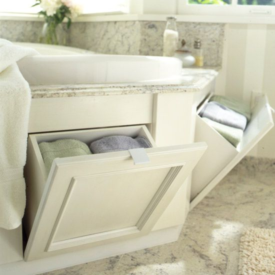 Tilt-out bins with recessed panel doors store towels, bubble bath, bath salts, shampoo, and conditioner. These products stay hidden until it's time to relax