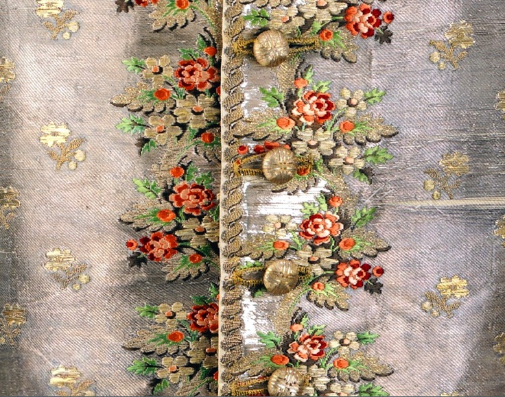 Detail front center of embroidery and gold metal buttons, Waistcoat, 1750-1770, British (probably) silk, metal, linen. Woven entirely out of metallic threads. Met Museum