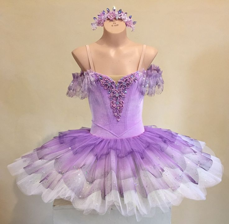 stacked, petaled, graduated layers of net in lilac over white