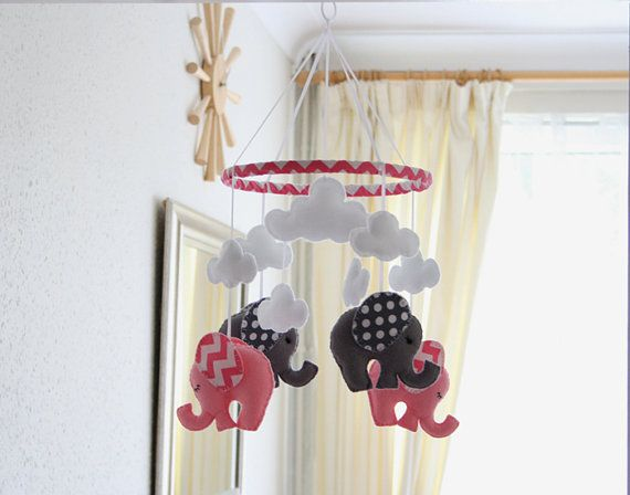 Welcome to FlossyTots   This beautiful Elephant mobile is MADE TO ORDER   The elephants come in baby pink & grey, with matching hot pink chevron & grey polka dot fabric ears and a decorated hoop of hot pink chevron fabric. In the centre are three fluffy white clouds and one cloud above each elephant.   APPROXIMATE DIMENSIONS: Wooden Hoop 9 Elephants 4.5 x 4.5 Large Cloud 5 x 3 Length from hoop to lowest elephant 12  Included is 4 of strong clear nylon thread which can easily be attach...
