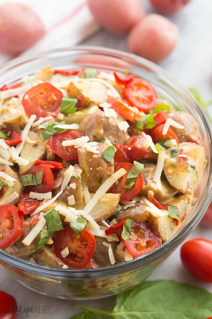 A fun new twist on classic Potato Salad! This Creamy Italian Potato Salad is filled with spinach, pesto, tomatoes, roasted red peppers and Parmesan cheese, it's perfect alongside grilled chicken or at any picnic!