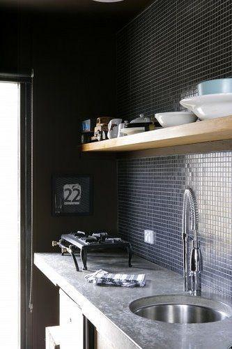 Black tile kitchen. No photographer credit