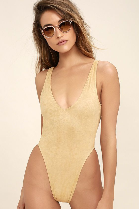 The surf is always up when the Kovey Surfari Beige Suede Backless One Piece Swimsuit is around! Luxe, vegan suede forms wide tank straps, plunging neckline, and retro-inspired, high-cut bottoms. Open back and cheeky bottoms. PLEASE NOTE: Swimwear returned without the hygienic liner is non-refundable.