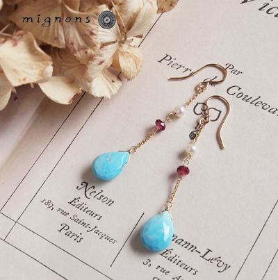 Long gemstone and gold earrings