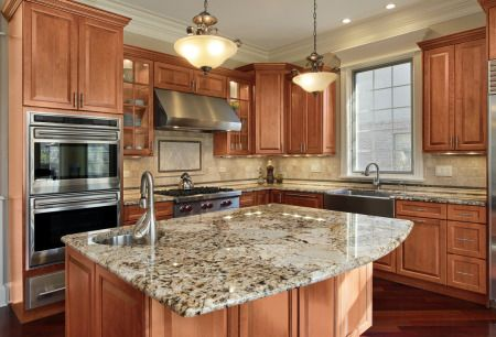 Looking To Update Your Kitchen? Try Furnishing Your Island With Marble And Top It Off With Maple Wood Cabinets!