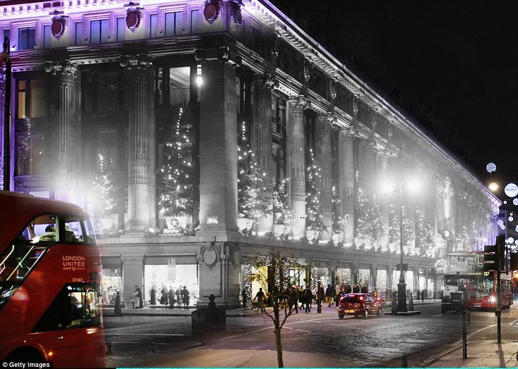 The photo shows Selfridges department store in 1935 and in 2014 - in 1935 the Oxford Street shop was lit up by dozens of Christmas trees