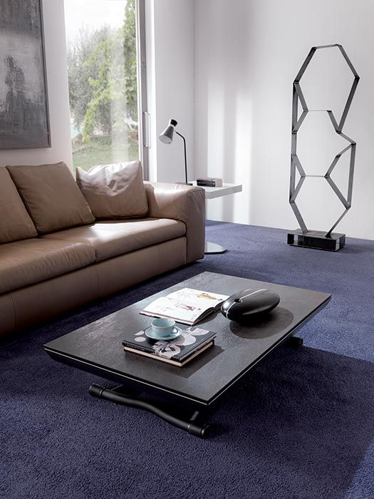 ICARO design: Marco Pozzoli  TRANSFORMABLE COUCH TABLE TURNS INTO A DINING TABLE. METAL BASE, GAS LIFTING DEVICE. ADJUSTABLE AT ANY HEIGHT, HIDDEN WHEELS, INSIDE EXTENSIONS