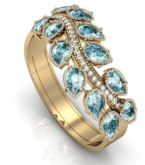 Bracelete em ouro amarelo com topázios e diamantes