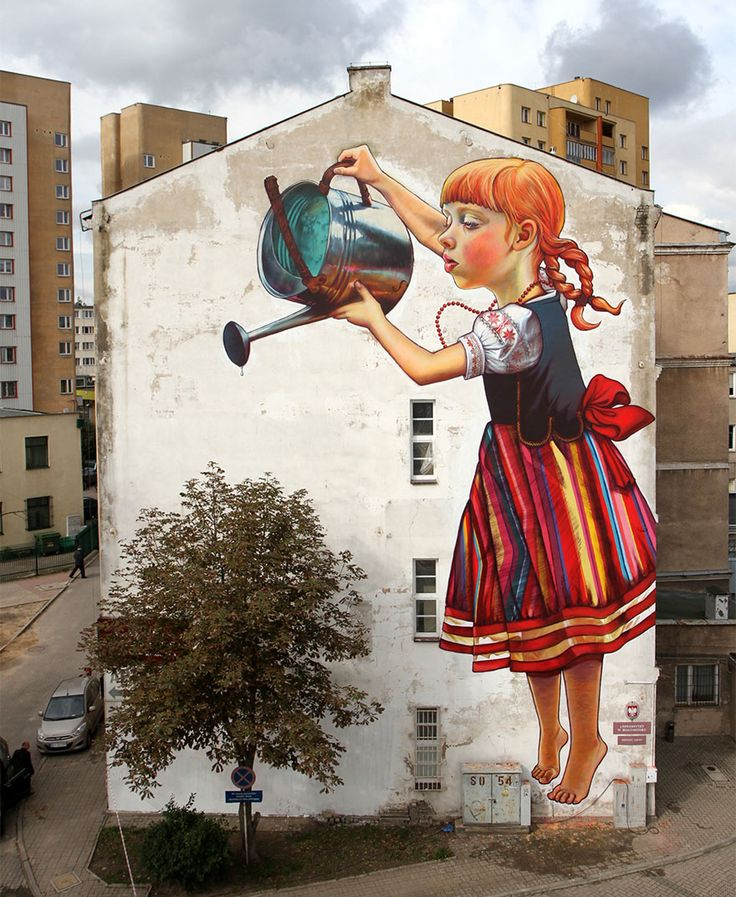 "Wall mural by Natalia Rak at Folk on the Street in Poland. Mural is called ""The legend of giants"" also known as ""Let's keep the plants alive"". Street art."