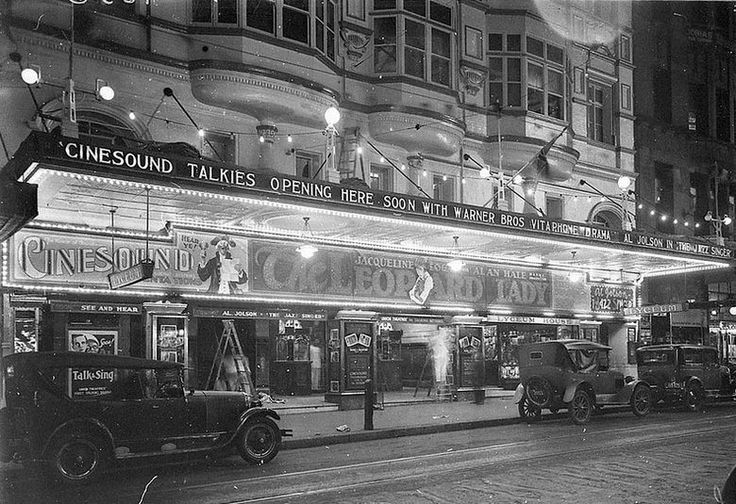 """Front of the Lyceum Theatre at night, Sydney [late 1928] with Jaqueline Logan and Alan Hale in """"The Leopard Lady."""" Also announcing: """"Cinesound Talkies opening here soon with Warner Bros. Vitaphone Drama, Al Jolson in 'The Jazz Singer' State Library NSW"""