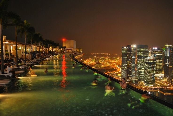 infinity pool marina bay sands skypark singapore. this pool stretches over the top of 3 hotel towers...