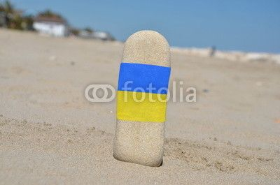 Flag of Ukraine on a vertical stones