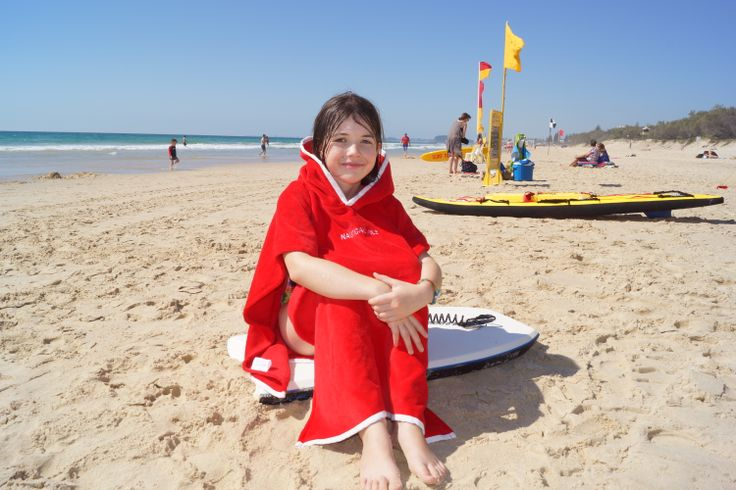 10 year old wearing red hooded beach towel by Nautical Mile Australia www.nauticalmile.com.au