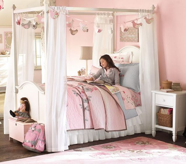 This is such a pretty little girl's room.  I love the pink, grey, and white together.