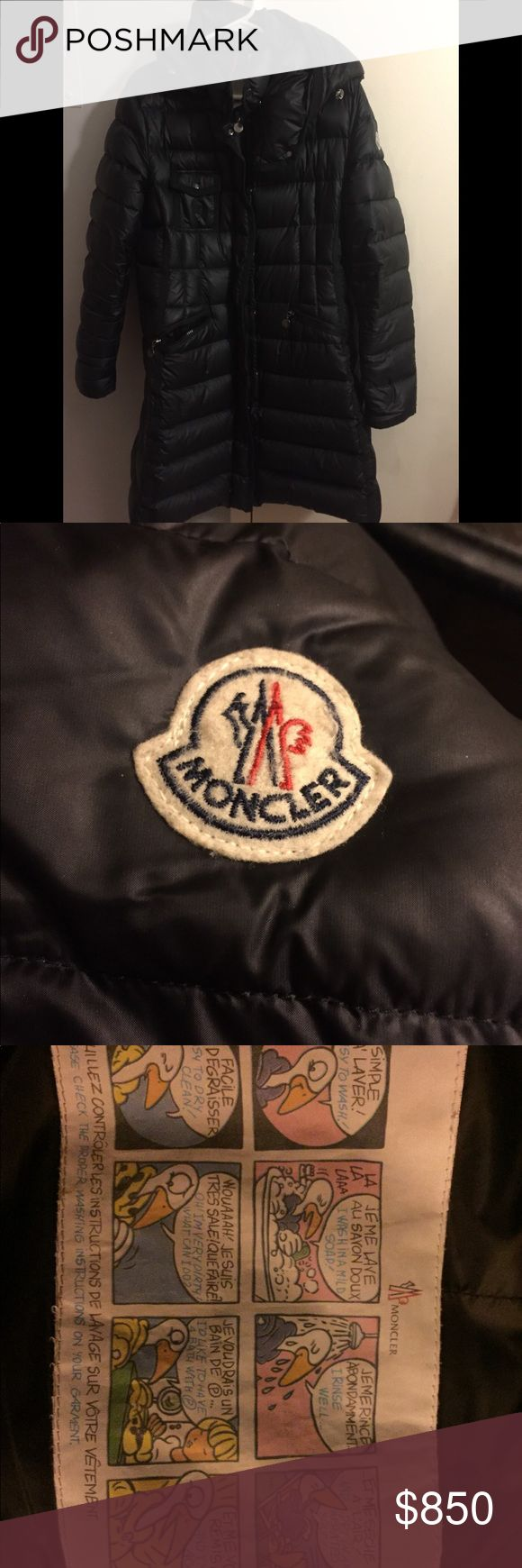 """Moncler Hermine Hooded Black Puffer Coat Moncler """"Hermine"""" long puffer coat 35"""" length (size 5).  In US, it's a 10-12. I lost weight so it's too big now - this coat is in EXCELLENT condition.  Purchased at Bloomingdales NYC end of last winter. Details: Hidden two-way zip closure with outer snap closure. Snap-off hood with elastic drawcord. Front zip pockets; snap-flap chest pocket. Moncler logo on left sleeve. Lined, with 90% down, 10% feather fill. 100% polyamide (nylon). Dry clean or hand…"""