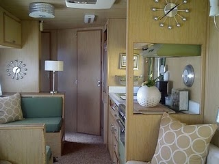 very nice airstream interior.....with 2 clocks just in case you forget the time. ;)