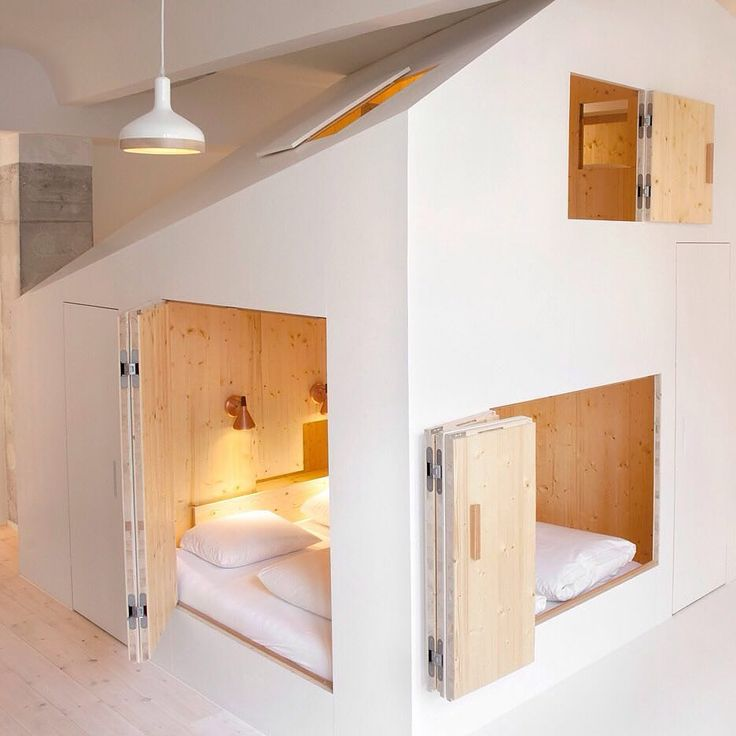 A wooden volume conceals the bedroom bathroom and sauna inside this Berlin hotel room which was recently overhauled by Danish architect Sigurd Larsen. Read the full story on http://ift.tt/1KNvVZy #interiordesign #hotels #berlin by dezeen