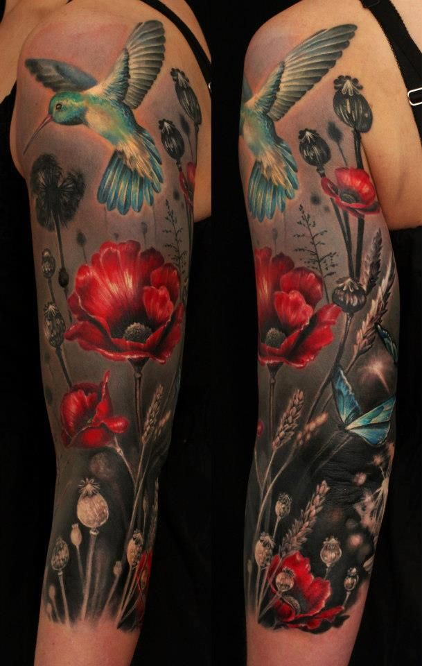 Humming bird and red poppy flowers tattoos on arm. Love the contrasting dark and bright colors.