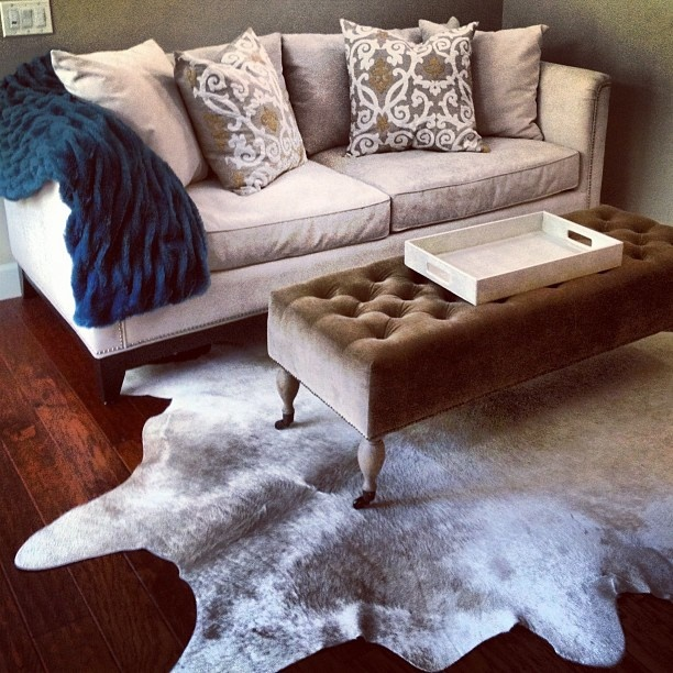 A Clic Yet Contemporary Living E With Z Gallerie Pauline Sofa Gabriel Pillows Pea Lazo Throw And Rio Cowhide Rug Styling By La Vie Est Belle