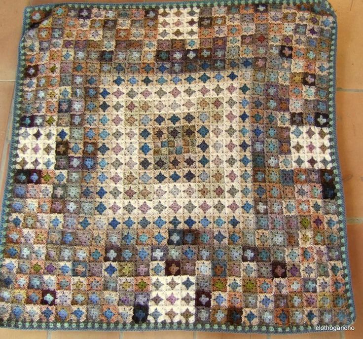 Crocheted afghan by clothogancho. The combination of blues and earth tones is breathtaking.