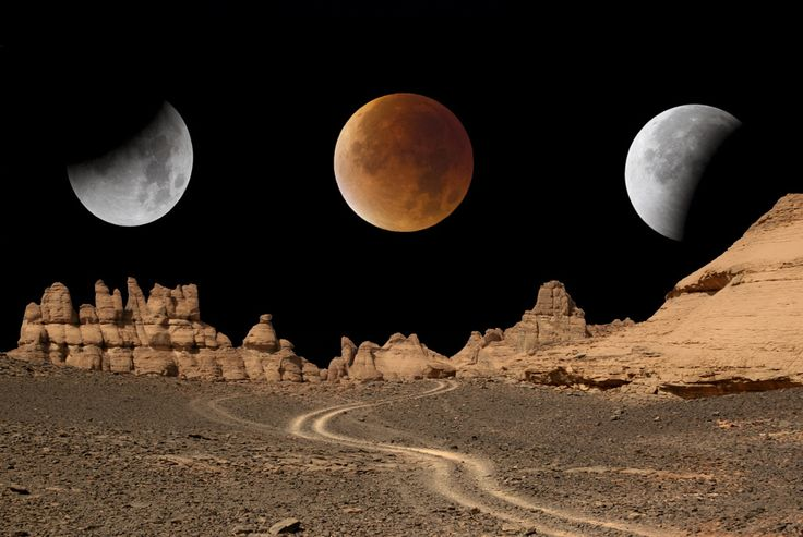 Lunar eclipse in the Acacus mountains in Libya