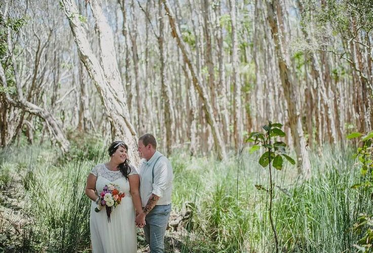 Beach Wedding. Illusion lace neckline with cap sleeves. Grey grooms suit. Broken Head beachside rainforest. Photography by David Moore Photography