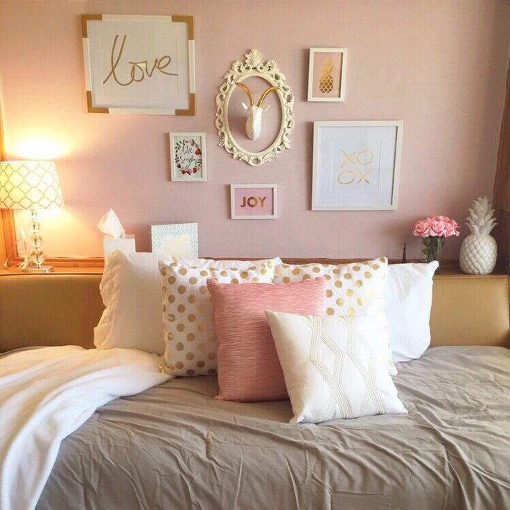 pretty pink and gold dorm room at texas tech university
