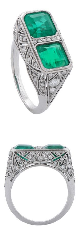 A Fine Art Deco Two-Stone Emerald Diamond Platinum Ring, A Fine Art Deco Two-stone Emerald & Platinum Ring, circa 1930, millegrain-set with a pair of step-cut stones, weighing a total of approximately 4cts, of Colombian origin, within an openwork frame pierced with palmette motifs & set with 8/8 cut & brilliant-cut diamonds.