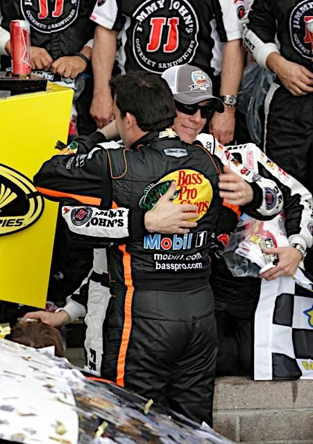 Tony Stewart hugging his friend, teammate, and employee Kevin Harvick in Victory Lane, 3/2/14