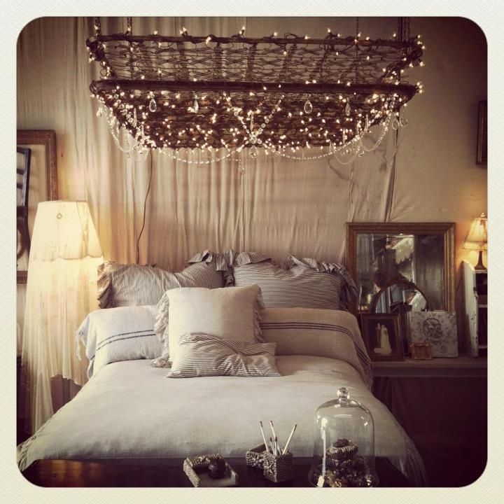I would love to lay in bed and look up at this vintage mattress spring bed display with lights.