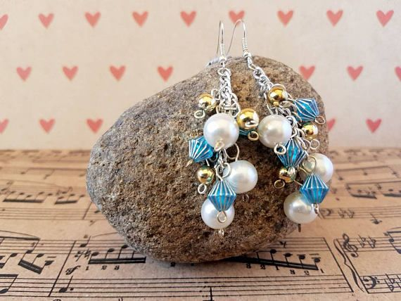 Check out this item in my Etsy shop https://www.etsy.com/au/listing/540198213/handmade-white-pearl-cluster-earrings