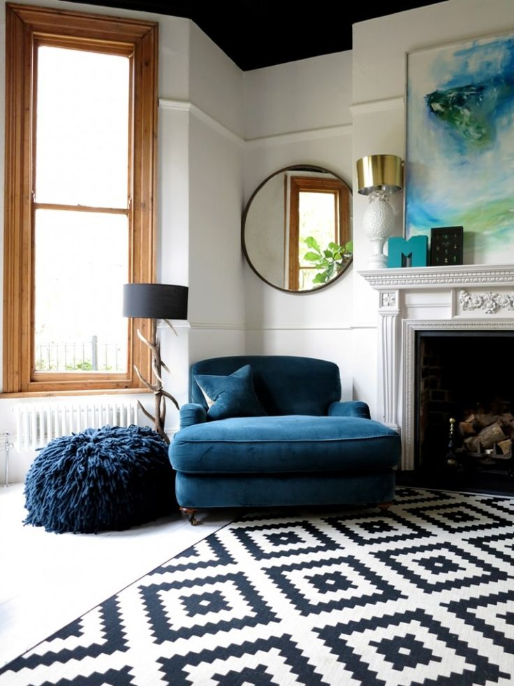 Big blue comfy chair and patterned rug in living room | 47 Park Avenue, Yorkshire | www.angelinthenorth.com