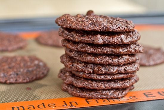 Flourless Chocolate Cookies (GF + Vegan) Recipe Desserts, Afternoon Tea with ground flaxseed, cold water, shredded coconut, brown sugar, cocoa powder, baking powder, baking soda, kosher salt, almond butter, almond milk, vanilla extract, semi-sweet chocolate morsels, macadamia nuts