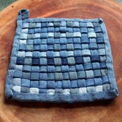 """denim potholder- cut 24 strips 2"""" x 10"""". Press each in half length wise, open and press each side in to meet the center. Cut 1 strip 2"""" x 24"""" (or piece together) for binding. Sew top and right sides to a small strip of fabric 1/2 x 10"""" to secure for weaving. Weave strips together and secure last two sides. Finish with binding."""